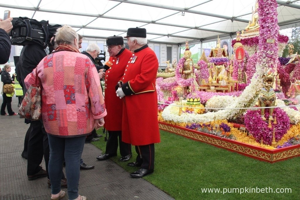 Chelsea Pensioners being interviewed in front of the Nong Nooch Tropical Botanical Garden, an amazing exhibit featuring hundreds of cut orchid flowers.