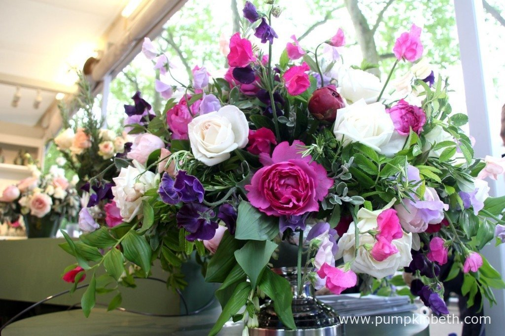 A beautiful floral arrangement of sweet peas and roses from The Real Flower Company at the RHS Chelsea Flower Show.