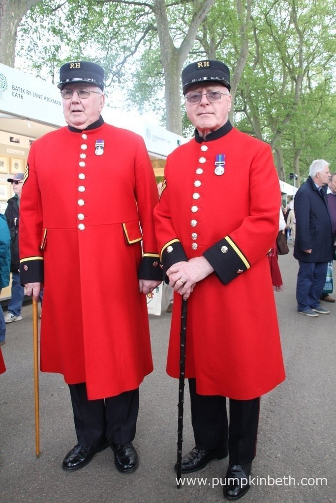 Two Chelsea Pensioners looking very smart in their scarlet coats.