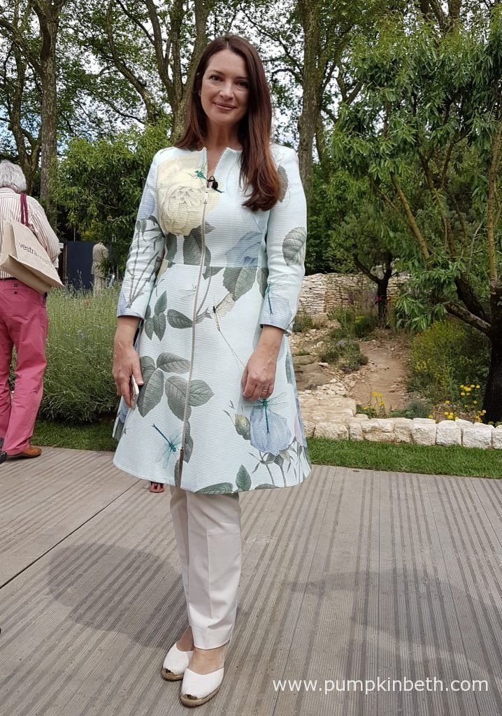 Rachel De Thame is pictured in front of the Show Garden that James Basson designed for L'Occitane, at the RHS Chelsea Flower Show 2016.
