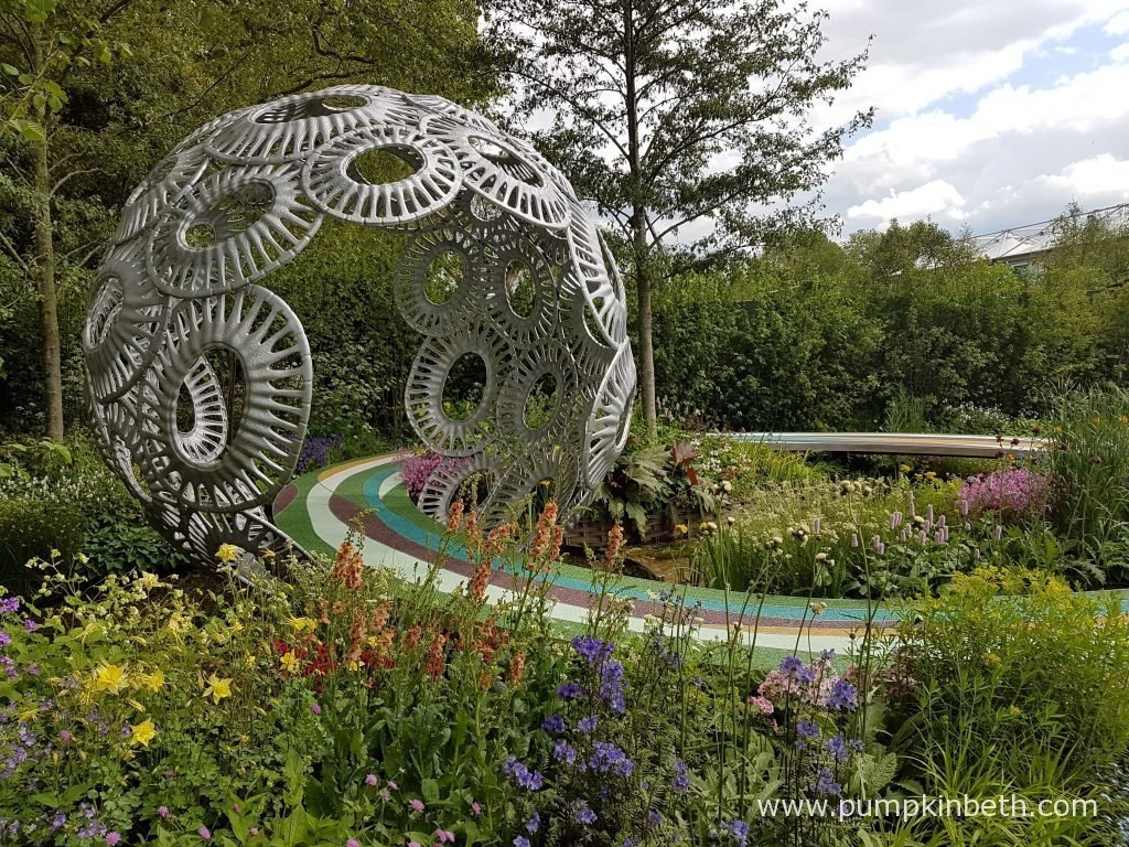 The Brewin Dolphin Garden - Forever Freefolk was designed by Rosy Hardy and built by Bowles & Wyer Contracts. This is Rosy Hardy's first Show Garden at the RHS Chelsea Flower Show. The Brewin Dolphin Garden - Forever Freefolk delivers an important message to highlight the importance, and the fragility, of chalk streams and the dangers they are enduring. Climate change, pollution, and man's own intervention have all contributed to the loss of chalk streams, which provide a beautiful, unique and vital habitat to many plants and a vast array of wildlife. There are now only 200 chalk streams flowing on Earth, the majority of these reside in the south of England, where they are in danger, threatened by climate change, pollution, and abstraction. The River Test, which flowers through Freefolk in Hampshire is a good example of a chalk stream, and accordingly has been represented in this special garden. Chalk streams are fed from groundwater aquifers, water is filtered through the chalk, this filtering produces water of high clarity and high mineral content, the water is enriched with calcium, iron and other minerals found within the chalk. This high quality water, provides a rich habitat and an eco-system for a vast array of wildlife – all aspects of the food chain thrive in and around chalk streams. Insects and other invertebrates prosper in the this special environment, in turn they provide a rich food source for the fish that live in these crystal clear waters. Watercress, water crowfoot, and starworts, are among some of the plants that flourish in the gravel beds of chalk streams, providing shelter from predators for fishes. Many plants grow readily on the river edges and margins, creating a beautiful, picturesque environment that should be celebrated and enjoyed. Sadly, the reality today is that only 25% of chalk streams are in good condition, abstraction for drinking water has caused some chalk streams to dry up and disappear, and pollution and run off from agricultu