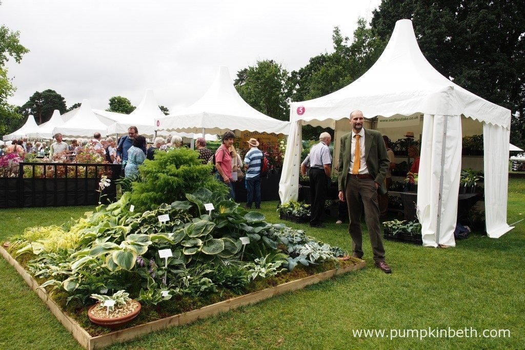 Mark Roberts from Stafford Lake Nurseries, a specialist Hosta Nursery based in Knaphill, in Woking. Mark is pictured with his stand that features lots of beautiful Hostas, at the RHS Wisley Flower Show 2016.