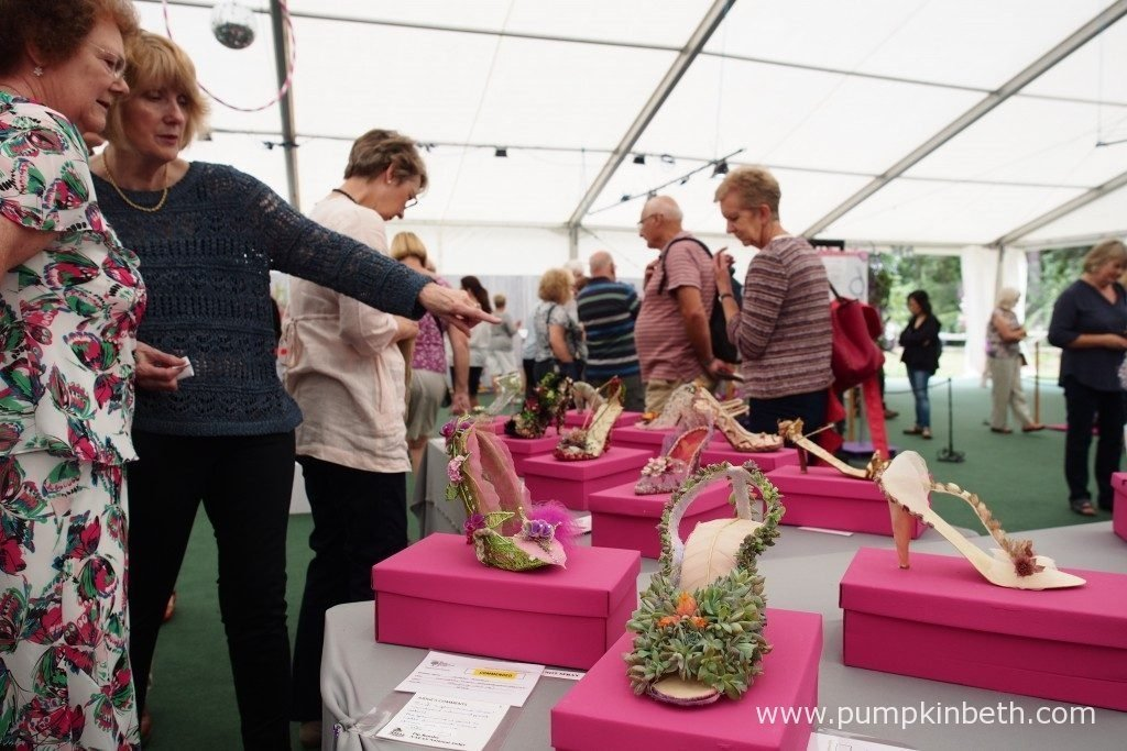 Beautiful floral shoes fit for a flower fairy, a princess or cinderella. Pictured in the Surrey NAFAS Floral Display Tent, at the RHS Wisley Flower Show 2016.