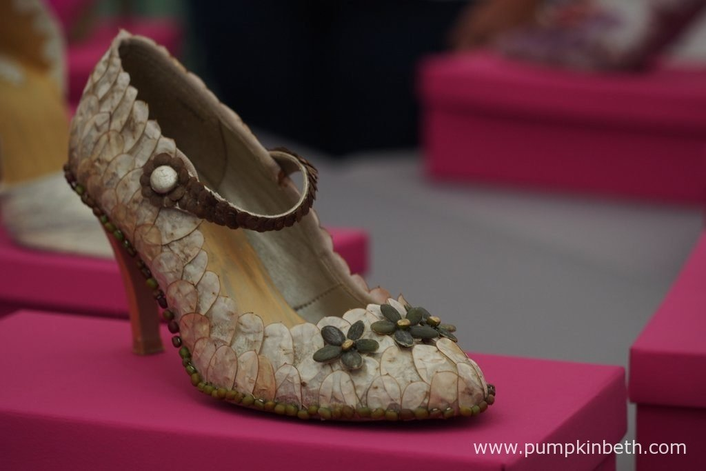 These beautiful shoes have been exquisitely decorated with honesty seed cases. This special shoe is part of a competition class called 'Stepping Out' at the Surrey NAFAS Floral Display, at the RHS Wisley Flower Show 2016.