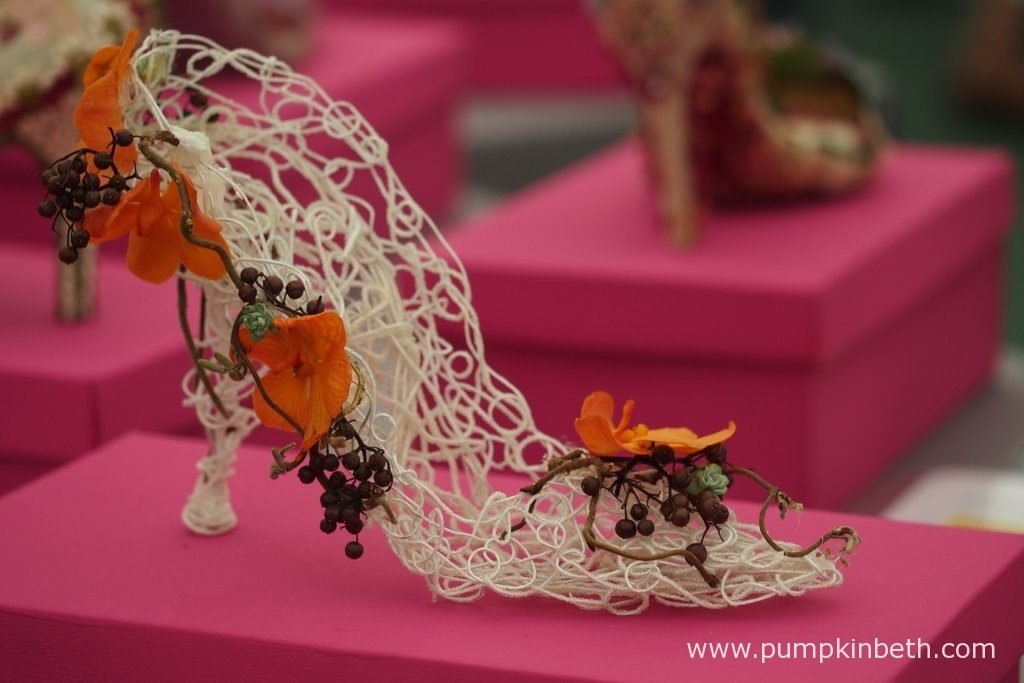 These intricately decorated shoes can be seen in the Surrey NAFAS Floral Display Tent, at the RHS Wisley Flower Show 2016.