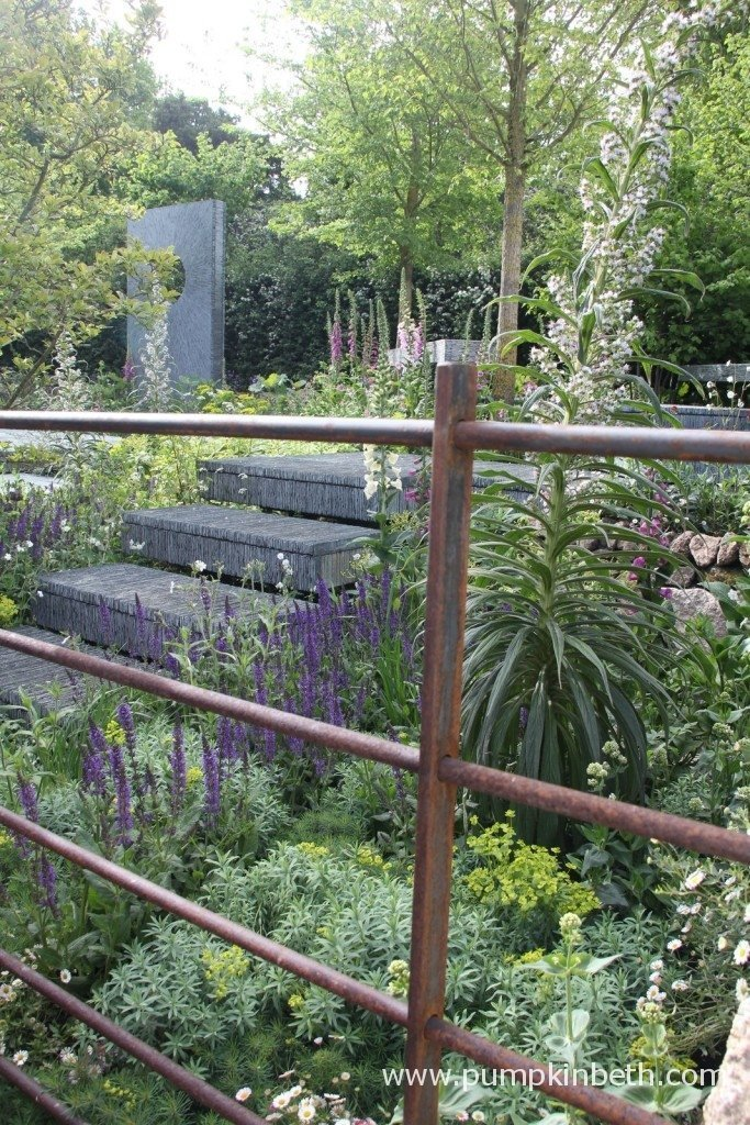 The Brewin Dolphin Garden, designed by Darren Hawkes, and built by Bowles and Wyer with Wheelbarrow. The surfaces of the suspended platforms in this garden are covered in more than 40,000 pieces of hand cut slate!
