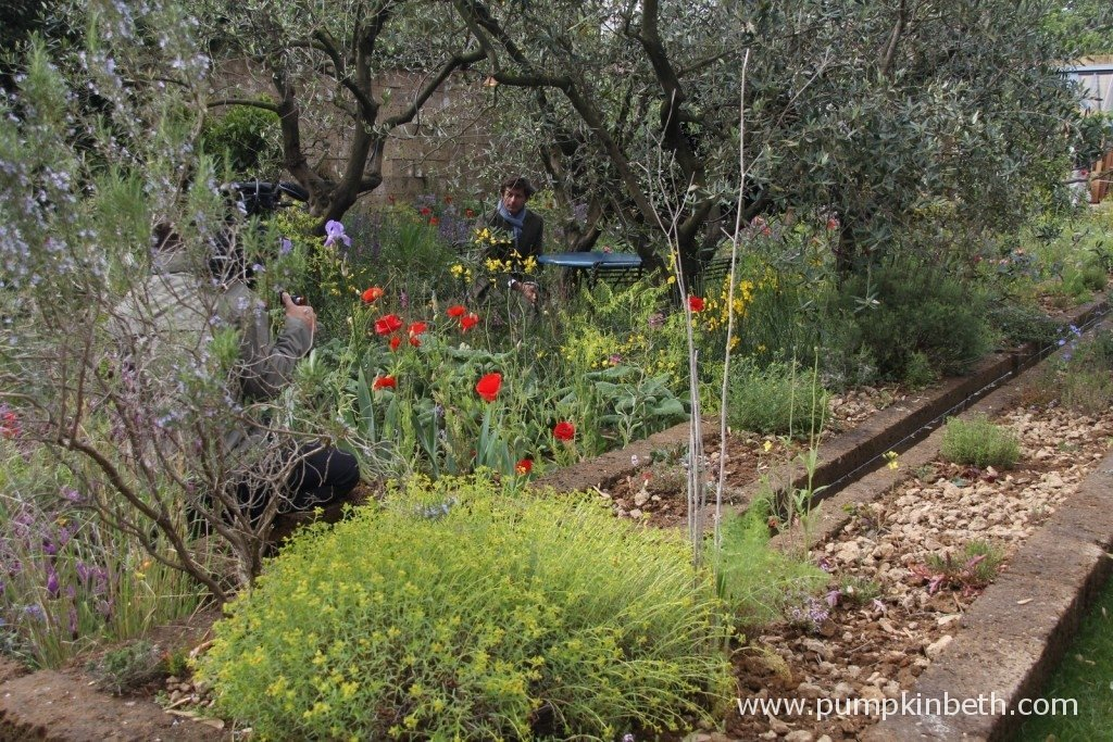 Here's A Perfumer's Garden in Grasse by L'Occitane, designed by James Basson, and built by Peter Dowle.  The designer, James Basson, is being interviewed in his garden in this picture.