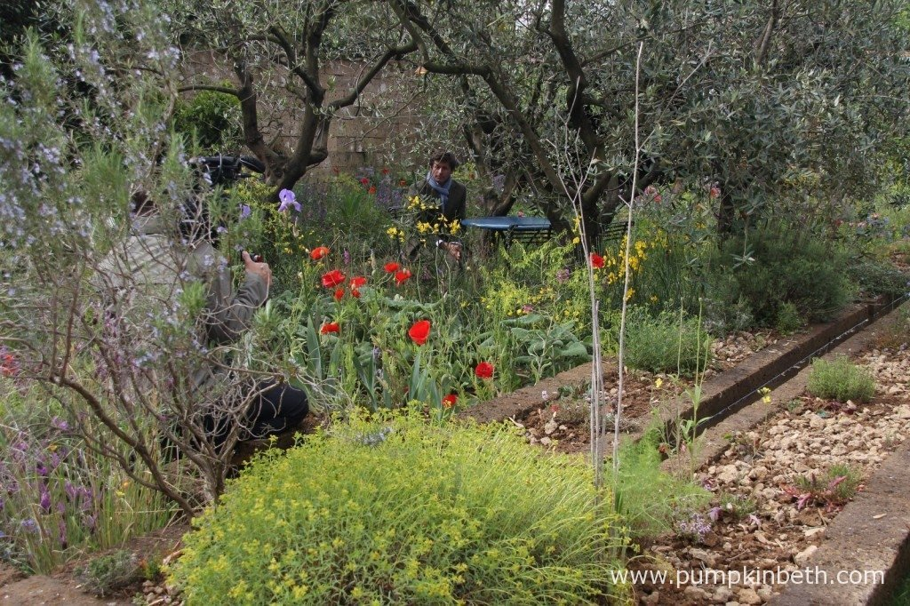 James Basson being filmed in the garden he designed for the RHS Chelsea Flower Show, 'A Perfumer's Garden in Grasse by L'Occitane'