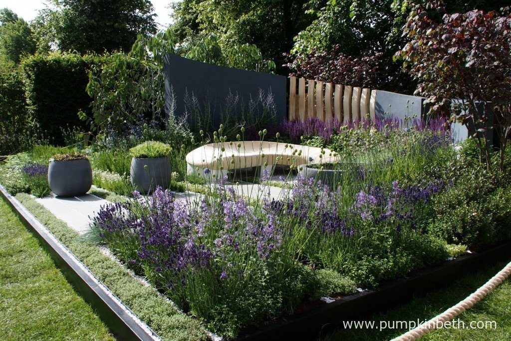 Living Landscapes: Healing Urban Garden was designed by Rae Wilkinson and built by Living Landscapes. The curved bench was designed in collaboration with Alun Heslop especially for the garden.