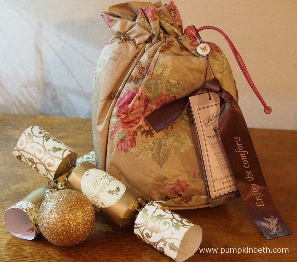 The Garden Girl Rain Poncho its waterproof bag.