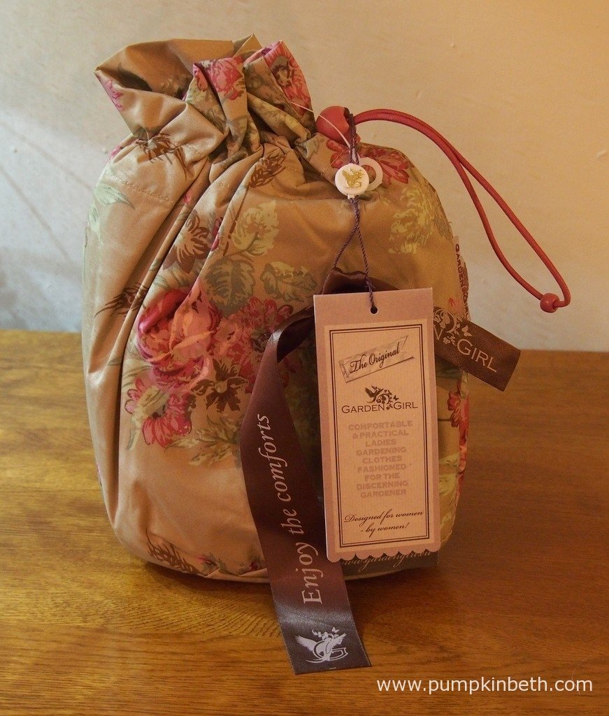 The Garden Girl Rain Poncho arrives in it's own waterproof bag.
