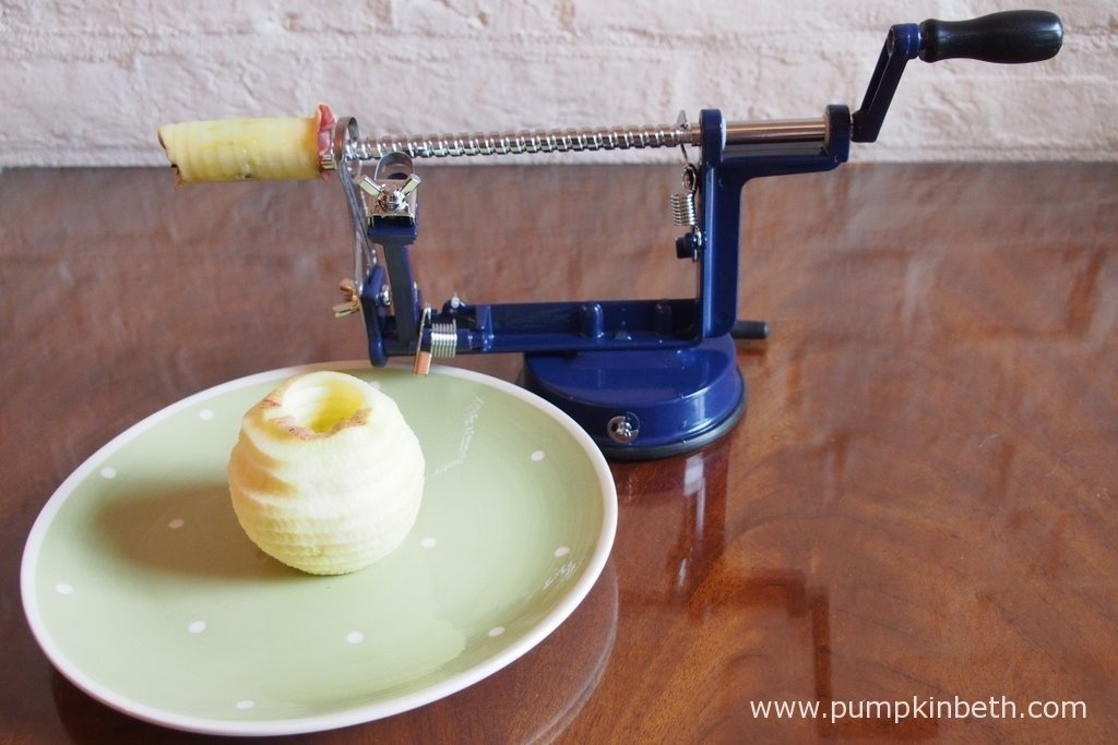 The Apple Master with an apple that has just been peeled, cored and sliced. I left the apple core on the prongs for this photo, so you can see more of how the device works.
