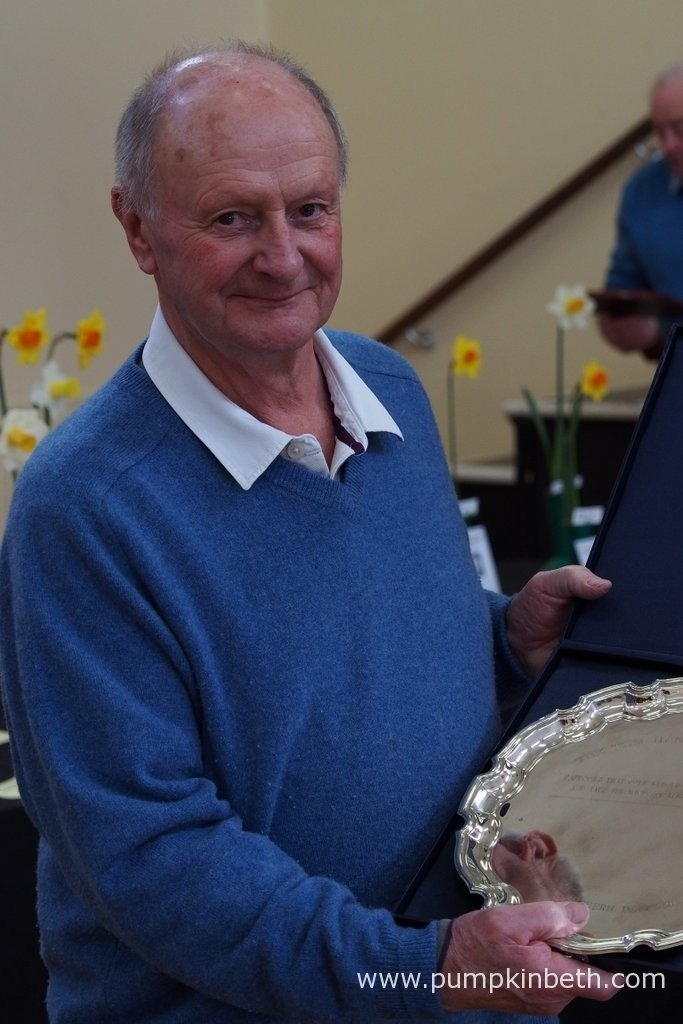 Richard Tabor is pictured with the silver platter he was awarded at The Daffodil Society Mid Southern Group Spring Show 2016.