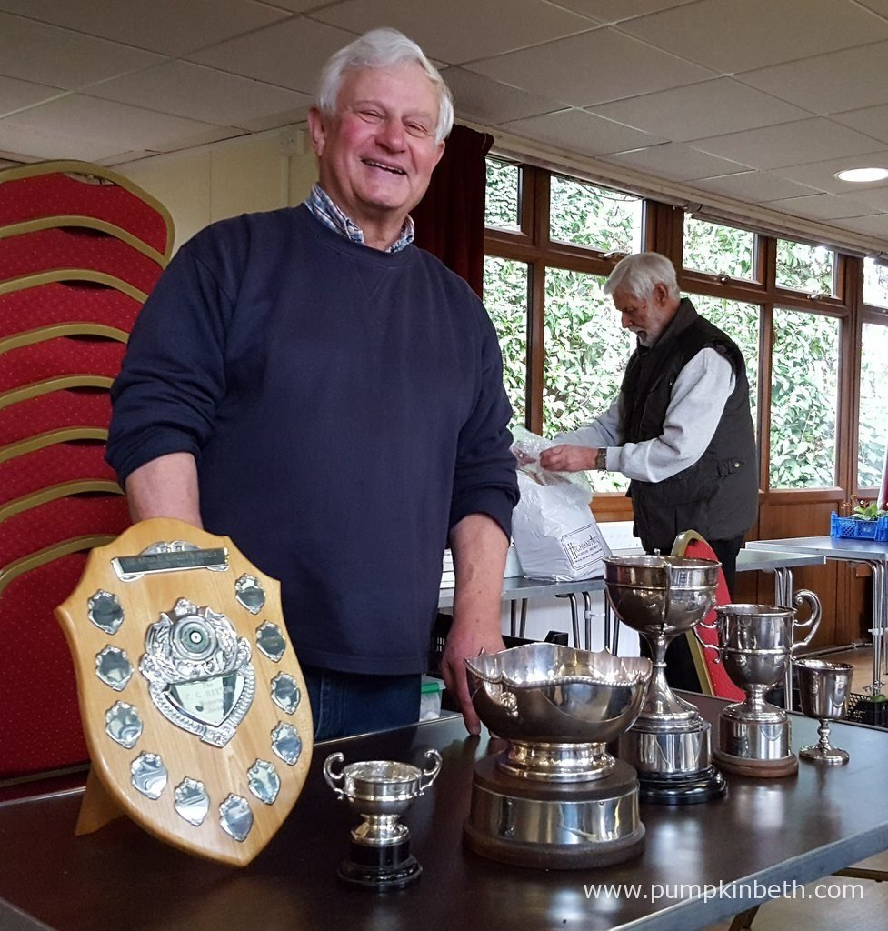 John Powell pictured with his haul of trophies at The National Auricular and Primula Society Southern Section 132nd Auricula Show in Great Bookham, Surrey.