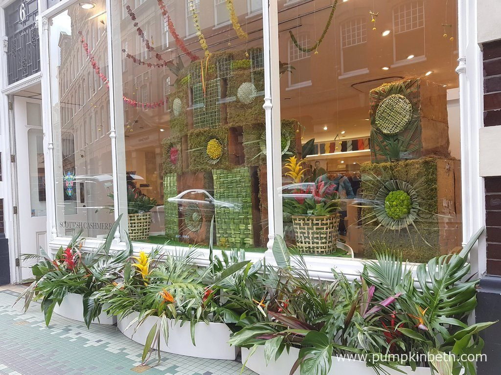 The floral art for this store featured cubes decorated with moss and leaves.