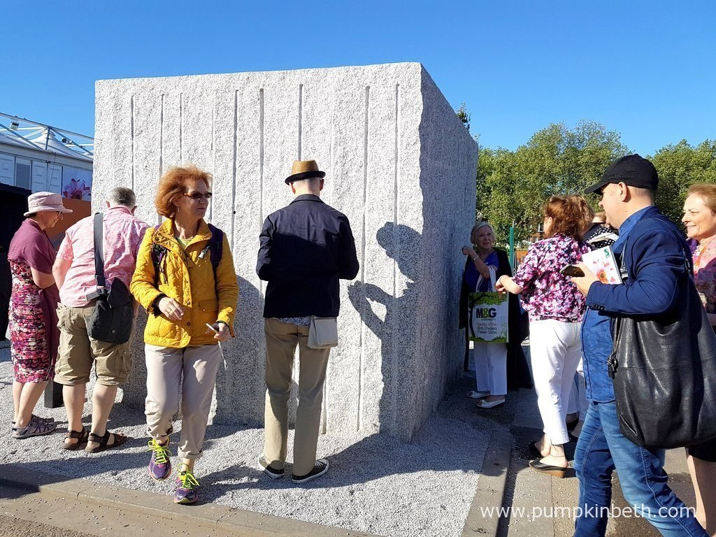The Marble and Granite Centre - Antithesis of Sarcophagi is a thought provoking garden, a cube garden - a garden within a cube; one that you have to get up close to, then find a small opening in the cube, to look through, to be able to view the garden inside.