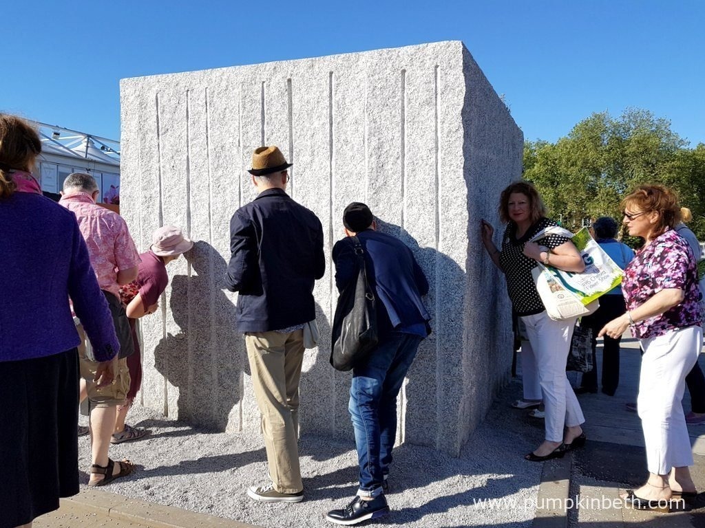 Visitors at The RHS Chelsea Flower Show 2016 all enjoying discovering the cube garden inside The Marble and Granite Centre - Antithesis of Sarcophagi, at The RHS Chelsea Flower Show 2016.