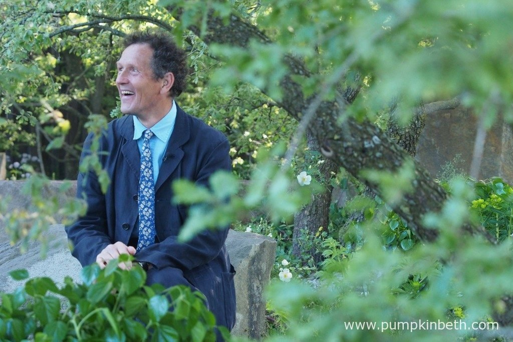 Monty Don broadcasting from Cleve West's M&G garden.