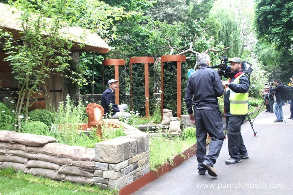 Lee Bestall being filmed for Yorkshire TV at The RHS Chelsea Flower Show 2015, in The Brewer's Yard by Bestall & Co Landscape Design, with Welcome to Yorkshire. Brewer's Yard by Welcome to Yorkshire celebrated Yorkshire Breweries, and featured elements from modern and historical beer brewing throughout the garden. This garden was designed by Bestall & Co Landscape Design, and sponsored by Welcome to Yorkshire. The garden was built by Aire Valley Landscaping Service Ltd.