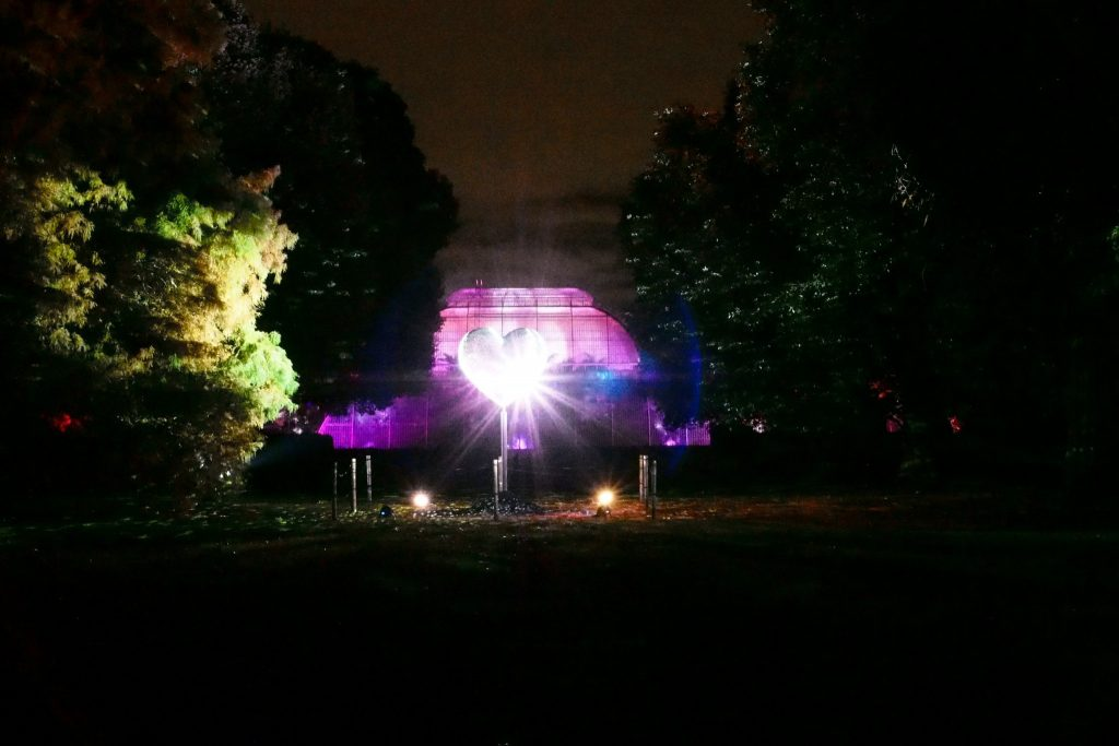 This giant, rotating, love heart disco ball light installation, was created by Stephen Newby, it's entitled Heart of Stars, and is positioned outside the Palm House at the Royal Botanic Gardens at Kew. Pictured during the Christmas at Kew 2016 event.