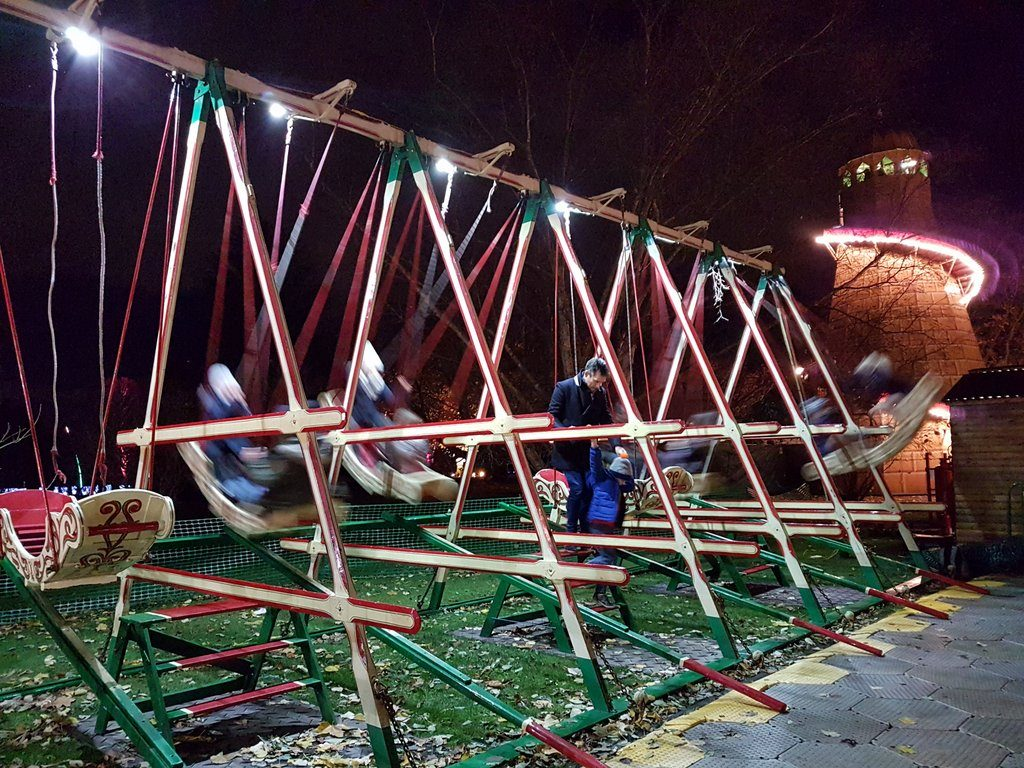 The swing boats and Helter Skelter at the Christmas at Kew 2016 event, held at the Royal Botanic Gardens, Kew.